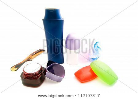 Hairbrush And Other Toiletries On White
