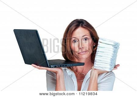 Business Woman Mom Holds Laptop And Stack Of Diapers