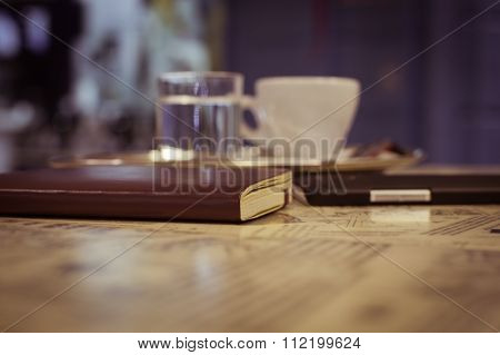 Notebook, Smart Phone And A Cup Of Espresso On A Table