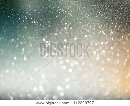 Christmas Background. Golden Holiday Abstract Defocused Background With Snowflakes and Stars. Blurred Bokeh