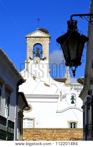 Bell tower on the surrounding wall around Faro old town