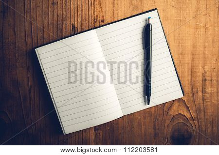 Open Notebook With Blank Pages And Pencil