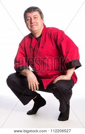 Squat man in red and black uniform, chef, cook, butcher