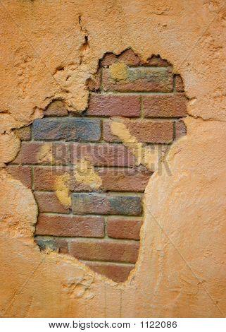 Stucco Over Brick Wall