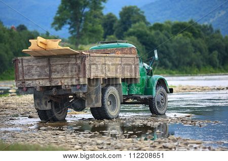 Old Truck Transports Cargo Wade Across The River