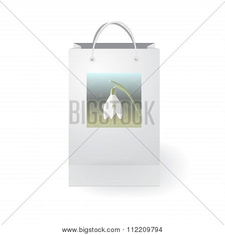Stock Vector Isolated Paper Shopping Bag On The White Background With Snowdrop