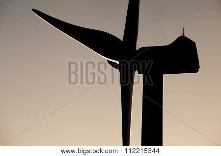 Close up of windmill with sunset lights.
