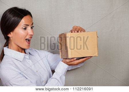Surprised Young Lady Opening A Package