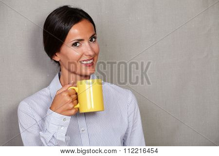 Happy Young Lady Holding Hot Drink