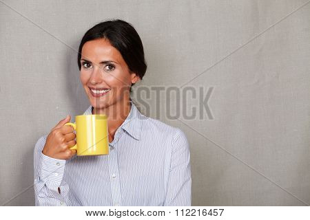 Smiling Adult Female Holding Hot Drink