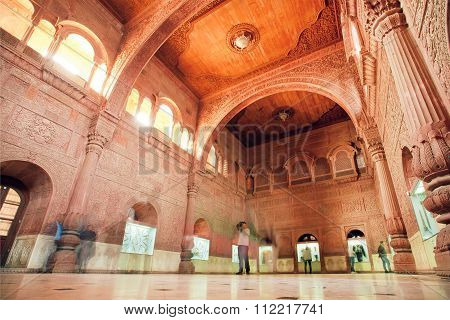 Motion Blurs From Walking Tourists Inside Carved Room Of 16Th Century Junagarh Fort