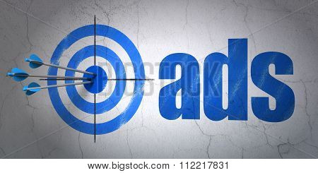 Marketing concept: target and Ads on wall background