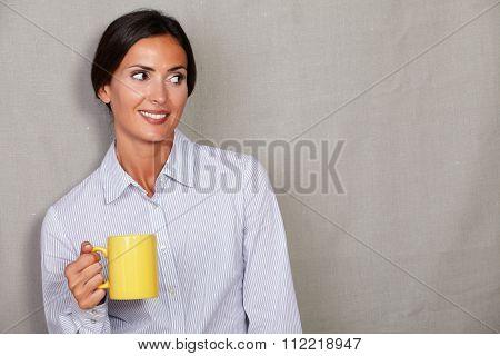 Satisfied Adult Female Holding Yellow Mug