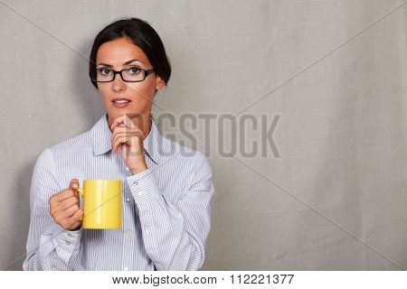 Well-dressed Woman Thinking With Hand On Chin