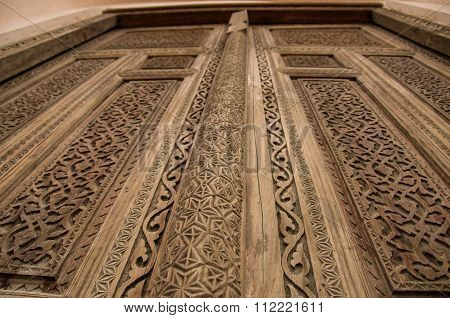 Brown Wooden Door With Traditional Carvings In The City Of Khiva, Uzbekistan