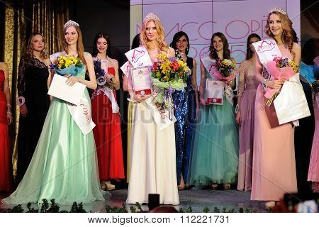 Orel, Russia - December 20, 2015: Miss Orel 2015 Beauty Contest. Miss Orel 2015 Julia Kupkova And Tw