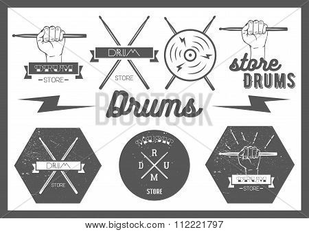 Vector set of vintage style drums labels, emblems and logo. Music design elements drum, drumsticks,