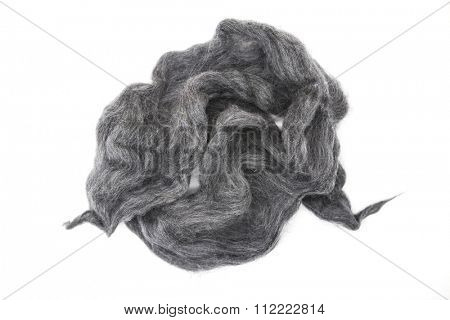 Gray piece of Australian sheep wool Merino breed close-up on a white background.