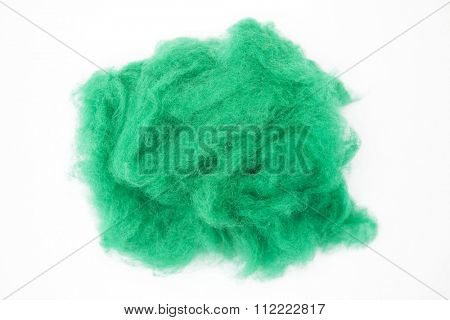 Emerald  green piece of Australian sheep wool Merino breed close-up on a white background.