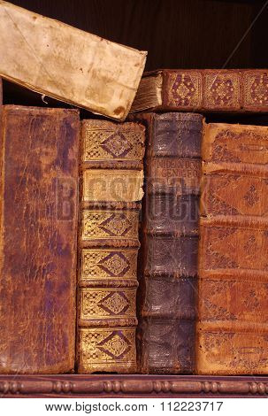 books historic on wooden shelf