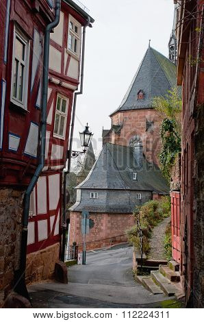 View Through A Gap Between Half Timbered Houses In Old Town
