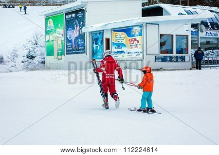 The child learning to ski and instructor on the slope in Bansko, Bulgaria