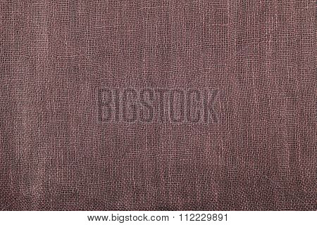 Closeup background photo of texture of Thai silk textile in Brown, Maroon color