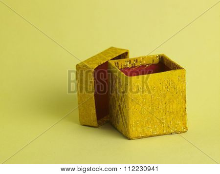 open yellow gift box on the yellow background