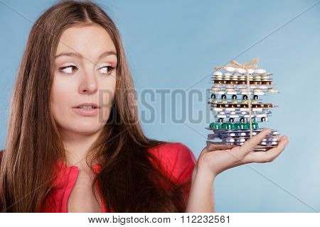 Woman Holding Pills Tablets. Drug Addict.