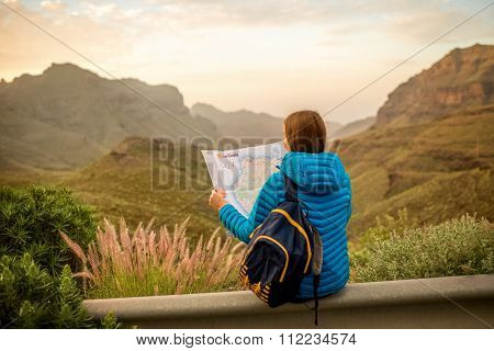 Female traveler with tourist map