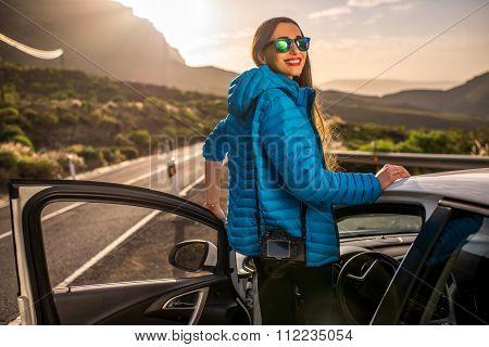 Female traveler near the car