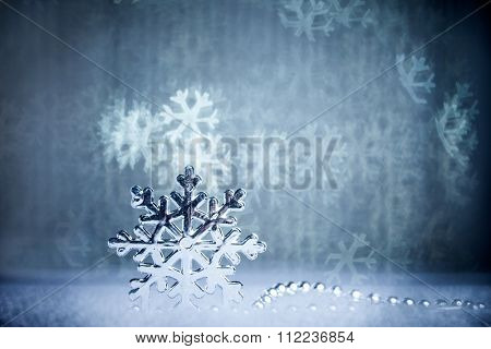 silver snowflake on shiny background