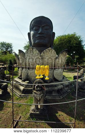 Black Buddha Head And Lotus Statue In Thai Contemporary Temple In Ayuthaya, Thailand