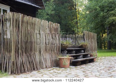 Ancient Wooden Fence In A Rural Homestead
