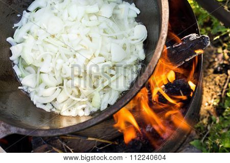 Large Pot Over A Campfire Cooking In Cast-iron Cauldron In Nature. Food, Camping, Cooking Over A Fir
