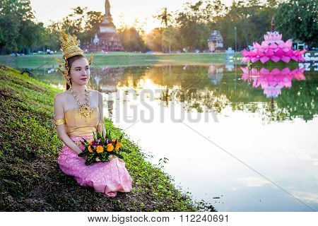 Thai lady with floating basket for Loi Krathong festival,Sukhothai