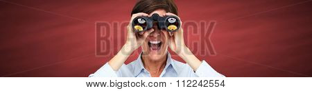 Business woman with binoculars over red chalkboard background.