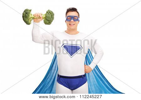 Superhero lifting a broccoli dumbbell