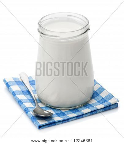 Yoghurt, cream, sour cream in a glass jar and spoon
