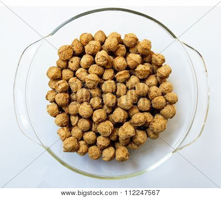 Superior quality soya nuggets or chunks kept on a glass bowl on a plain background