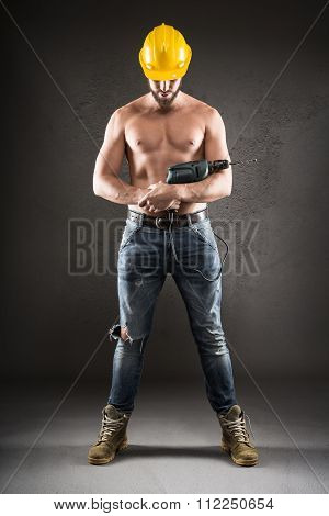 Portrait Of Attractive Shirtless Workman With Drill