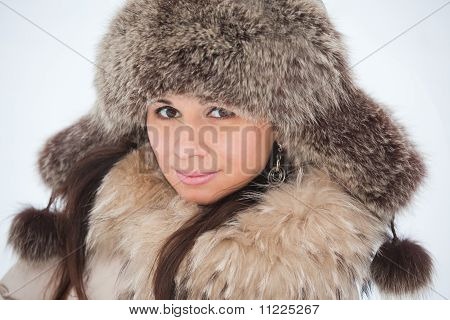 Beautiful Young Girl In Fur Clothing Laughing