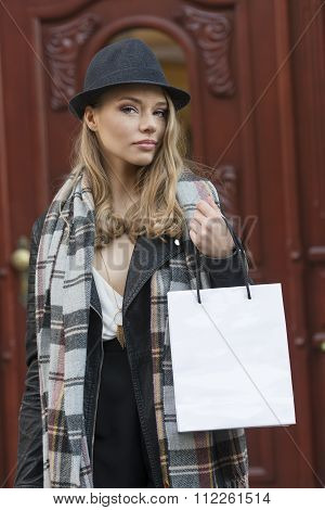 Girl After Shopping Near Door