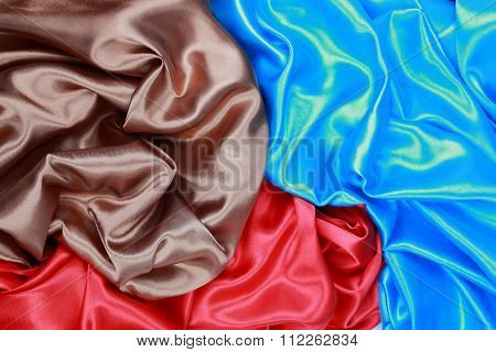 Blue And Brown And Red Silk Satin Cloth Of Wavy Folds Texture Background
