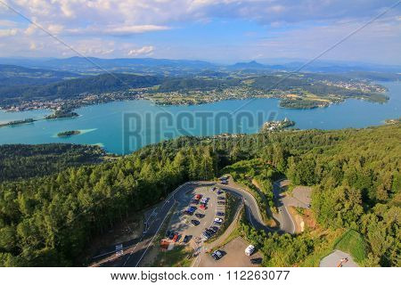 Landscape view of the Alpine lake, Woerthersee, and its parking lots in the southern Austrian state of Carinthia. Photo taken from the Pyramidenkogel Tower