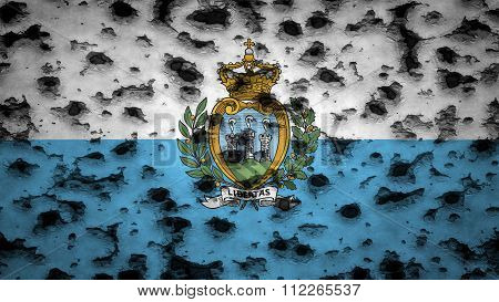Flag of San Marino painted on wall with bullet holes