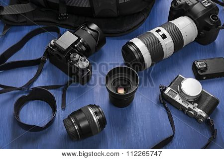 Photographer's equipment on a dark blue wooden background