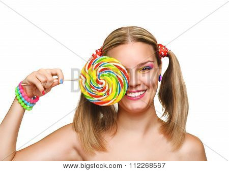 Girl eating colourful lollipop.
