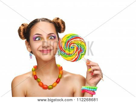 Girl eating colourful lollipop.
