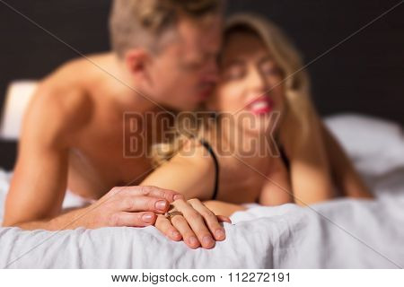 Woman and man making love